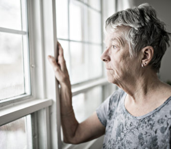 A sad lonely 70 years old senior in her apartment