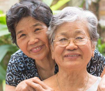 Two elderly women smiling